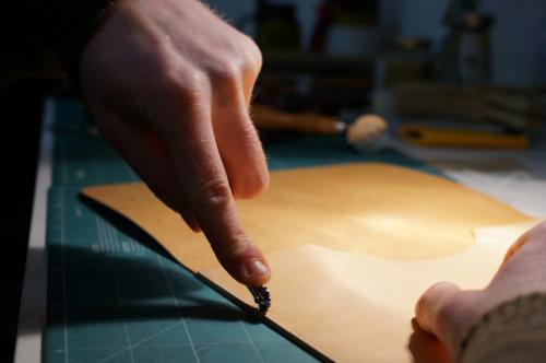 MES leather hand rolling