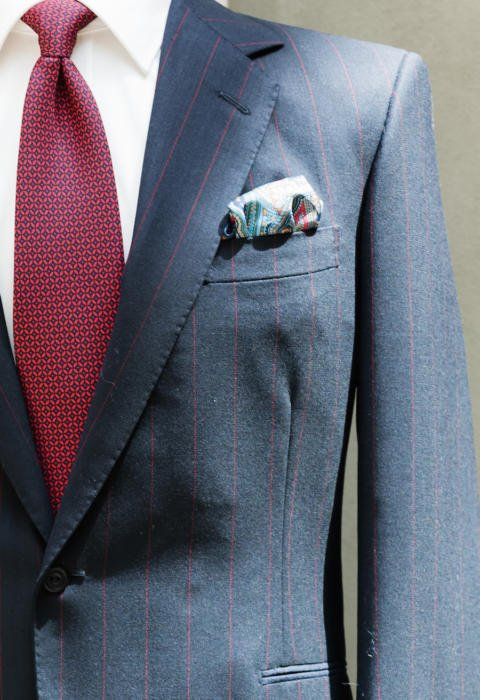 Richard Anderson red stripe suit Symposium