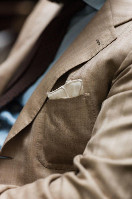 tan Caliendo jacket and cream pocket square