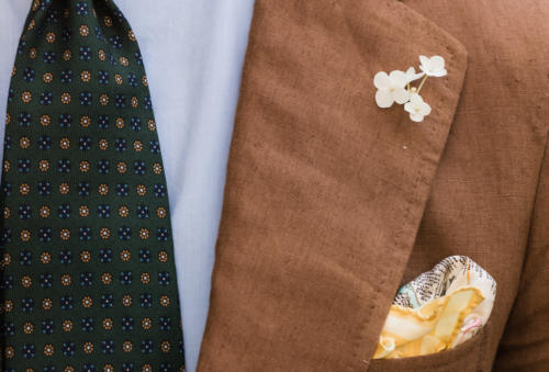 Brown linen suit with cream flower