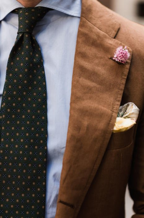 Brown linen suit with pink boutonniere