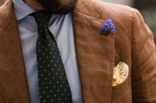 Brown suit with blue flower