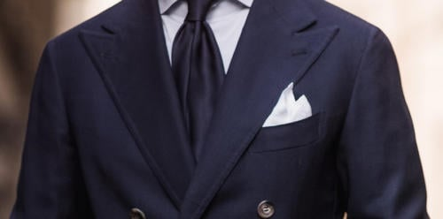 White handkerchief with navy blazer