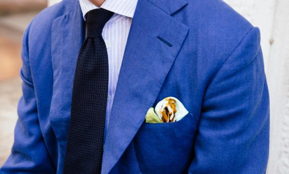 Blue linen jacket with navy grenadine tie