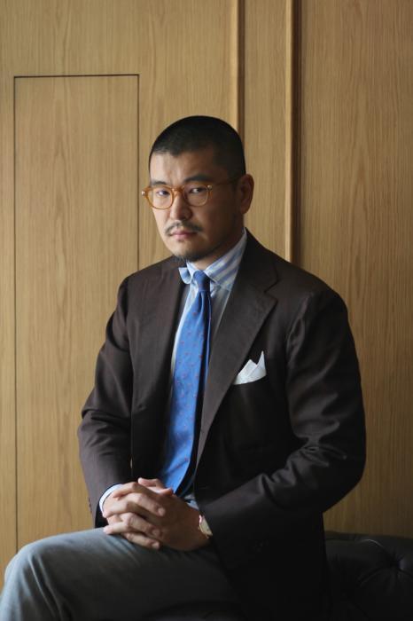 george-wang-in-tie-and-brown-jacket