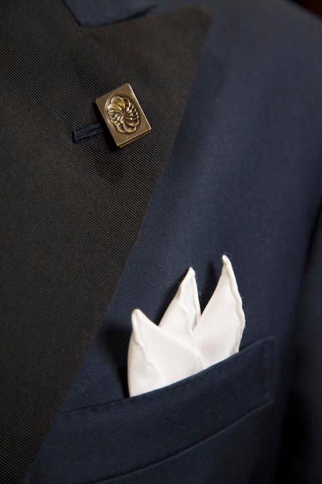 vintage cufflink worn as boutonniere