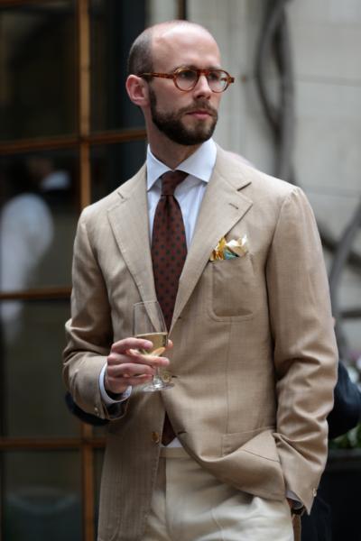 Tan jacket, orange tie