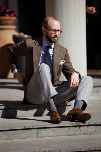 Brown donegal jacket, pale-grey flannels