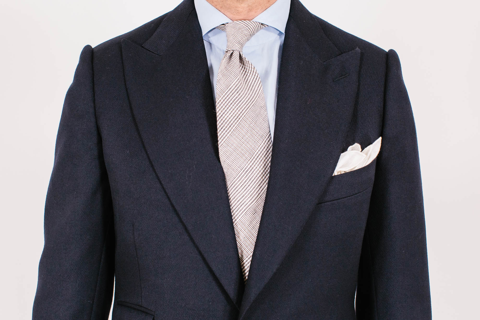 1e63eec2d937 The jacket is actually not as long as some others from the English tailors,  at 32 inches compared to between 31½ and 33 inches among those.