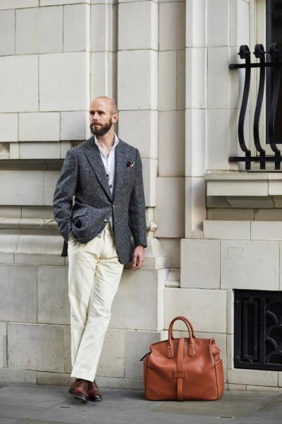 Charcoal jacket, cream trousers