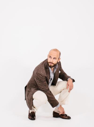 Brown jacket, cream sharp trouser