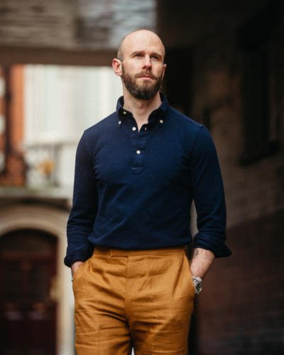 Navy polo with tobacco trousers