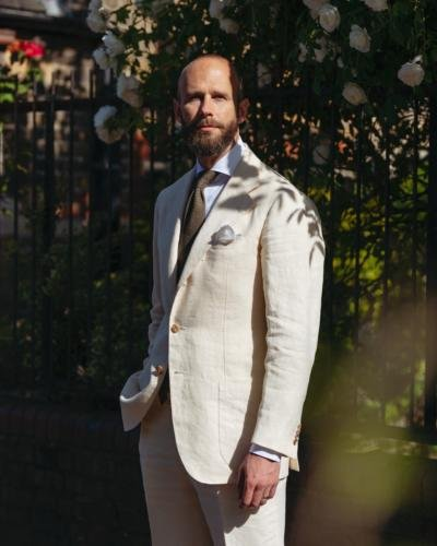 The cream summer suit - and green tie