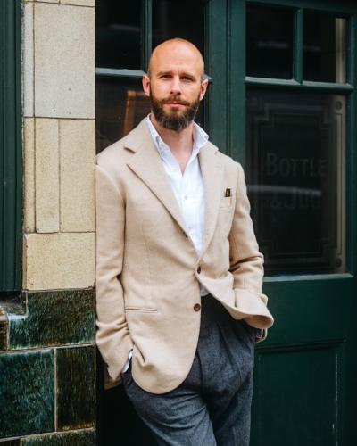 Oatmeal jacket, grey flannels, white oxford