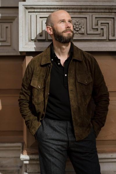 Black polo shirt with olive jacket