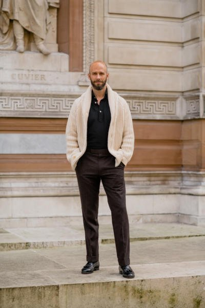 Cream knit, black polo, brown trousers