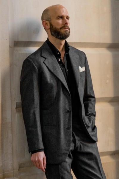 Black polo under flannel suit