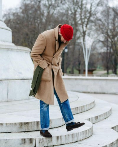 Red watch cap, green scarf, camel and denim